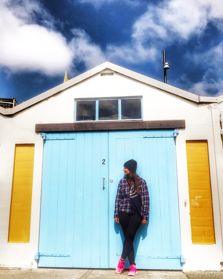 Girl in front of shed in Wellington