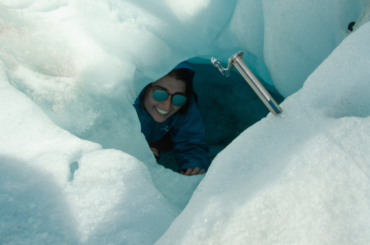 Girl smiling inside an ice cave
