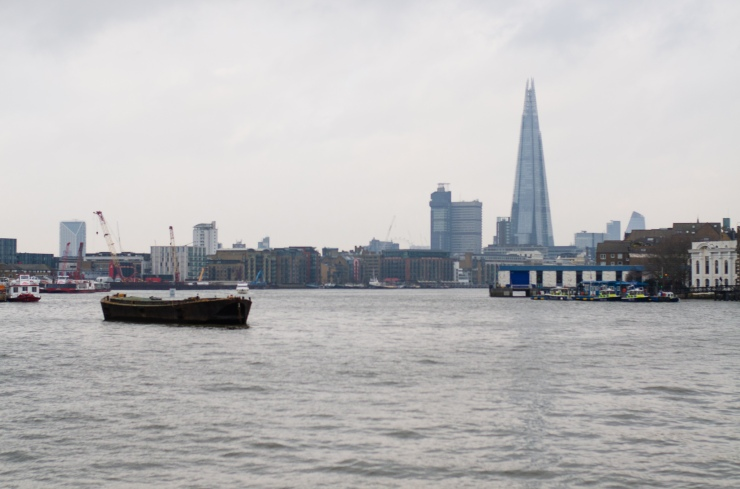 the shard in the background of the river