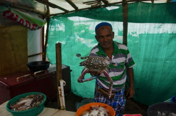 Fishmonger in Cochin with fresh crab