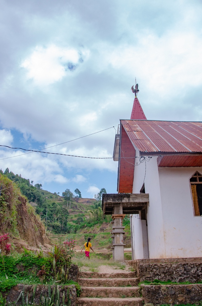 A villager walks into a local village church in Tana Toraja, Sulawesi
